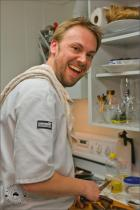 Chef Mike Betts, in the kitchen, having a blast.